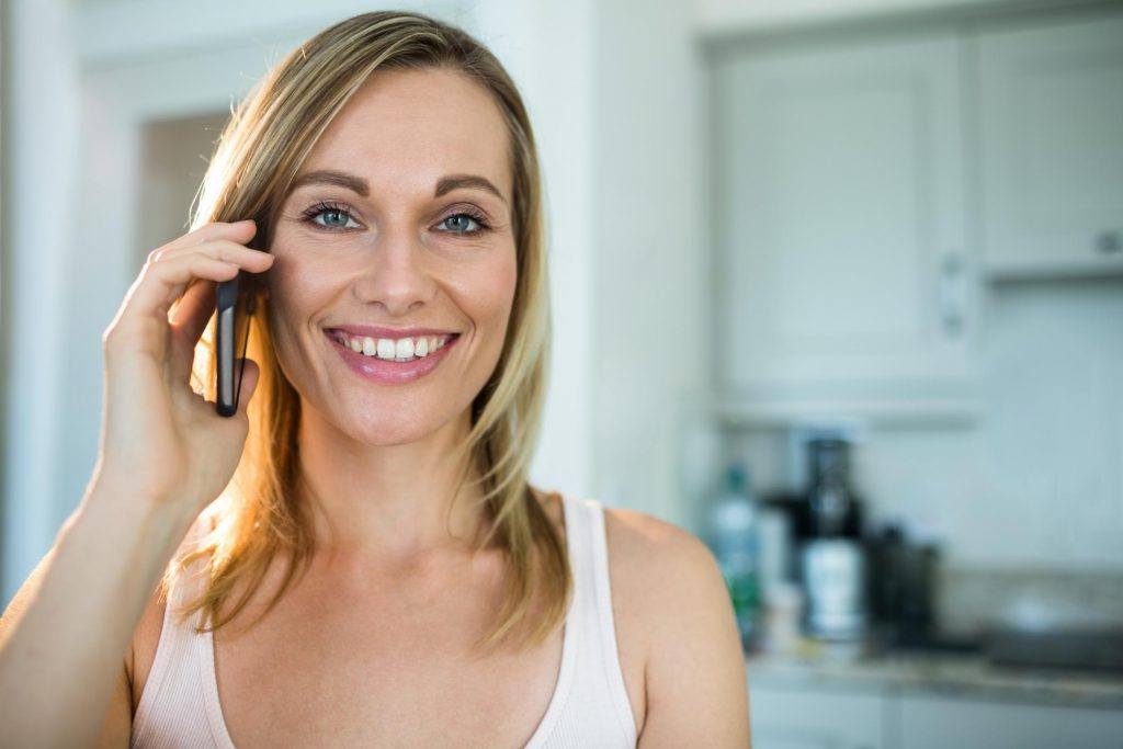 woman smiling taking phone call