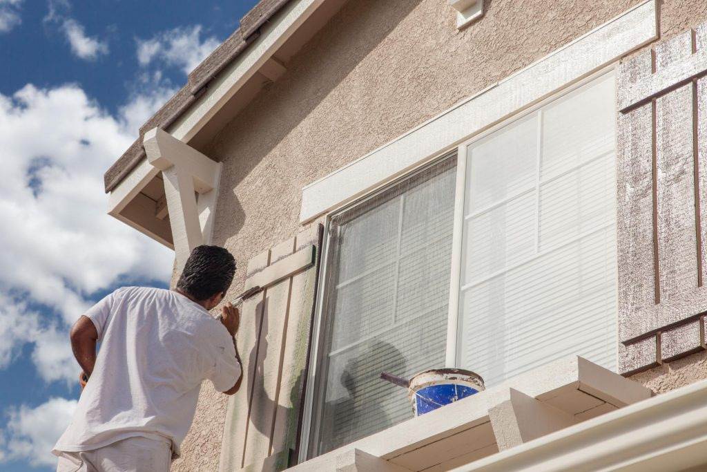 remodeling expert working on exterior painting